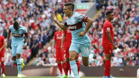 Lanzini celebrates after scoring AGAINST Liverpool